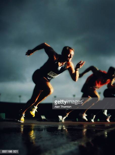 athletes leaving starting-blocks, (digital composite) - all weather running track stock pictures, royalty-free photos & images