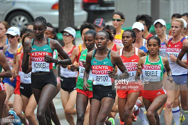 Athletes led by Priscah Jeptoo of Kenya compete in the Women's Marathon at the World Athletics Championships in Daegu on August 27 2011 AFP PHOTO /...