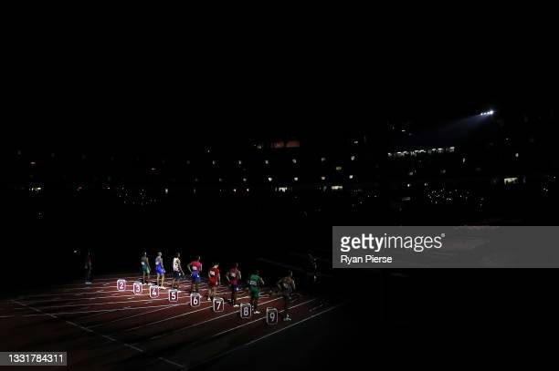 Athletes line up for the start of the Men's 100m Final on day nine on day nine of the Tokyo 2020 Olympic Games at Olympic Stadium on August 01, 2021...