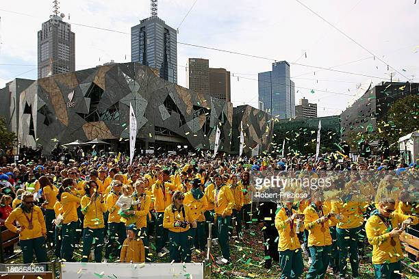 Athletes look on during the Australian Olympic Team Homecoming Parade at Federation Square on August 22 2012 in Melbourne Australia