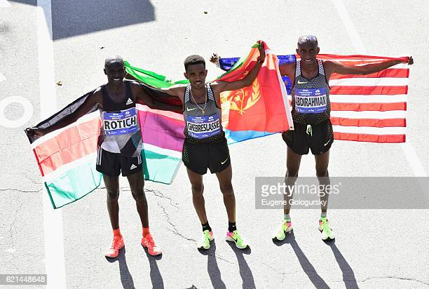 Athletes Lucas Rotich Ghirmay Ghebreslassie and Abdi Abdirahman pose after finishing the race with TAG Heuer Official Timekeeper for The New York...
