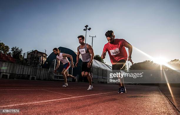 Athletes making an effort while running a sports race.