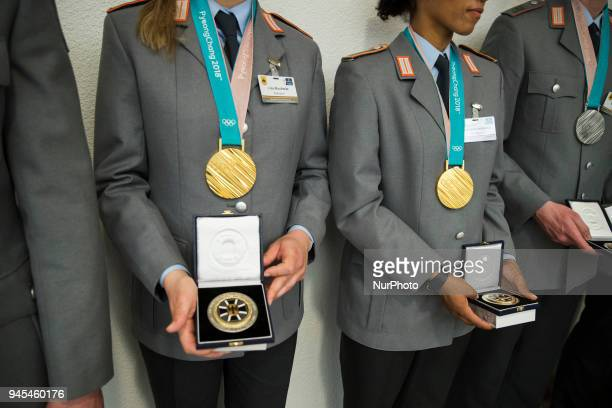 Athletes members of the German Army are pictured during a ceremony to honour the members of the Bundeswehr who attended the Winter Olympic Games in...