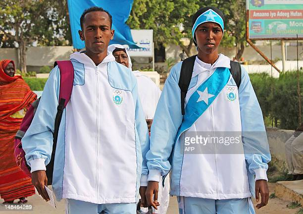 Athletes Mohamed Hassan Mohamed who will compete in the 1500m race and Zamzam Mahmuud Farah who will compete in the 800m race prepare to board an...