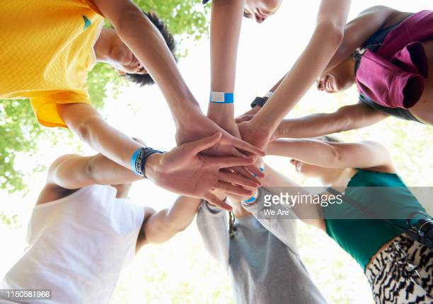 athletes motivating and supporting each other - sports team stock pictures, royalty-free photos & images
