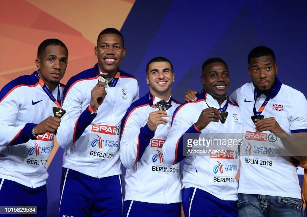 Athletes of England celebrate after winning the golden medal in men's 4x100m relay final during the 2018 European Athletics Championships in Berlin...