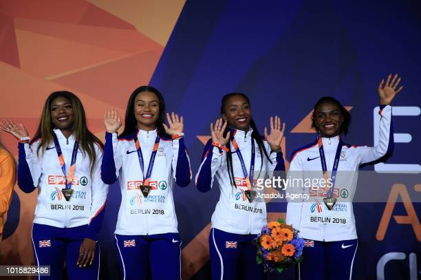 Athletes of England celebrate after winning the golden medal in women's 4x100m relay final during the 2018 European Athletics Championships in Berlin...