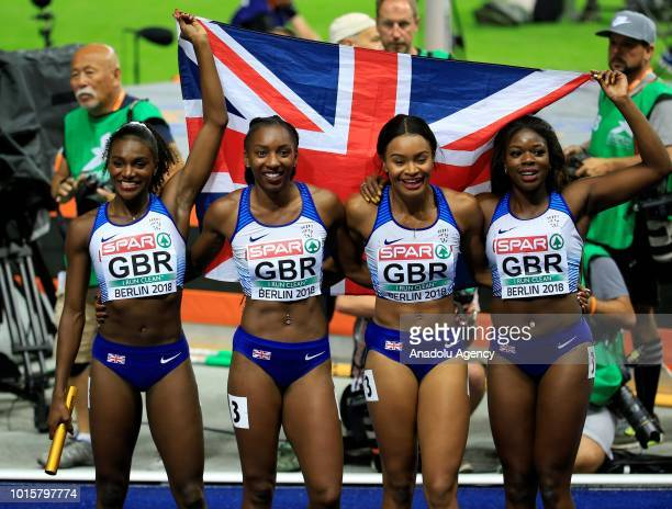 Athletes of England pose for a photo after winning the gold medal in women's 4x100m relay final during the 2018 European Athletics Championships in...