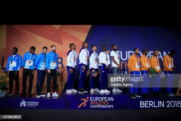 Athletes of England Turkish athletes and athletes of Netherlands celebrate after winning respectively the golden medal silver medal and bronze medal...