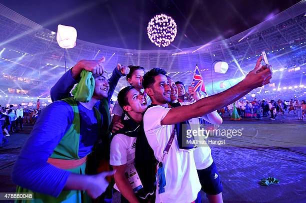 Athletes of Great Britain celebrate with performers during the Closing Ceremony for the Baku 2015 European Games at Olympic Stadium on June 28 2015...