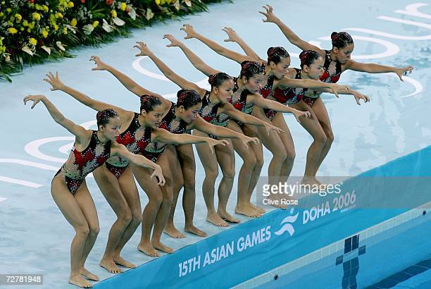 Athletes of Malaysia compete in the Team Technical Synchronised Swimming Routine at the 15th Asian Games Doha 2006 in the Hamad Aquatic Centre on...