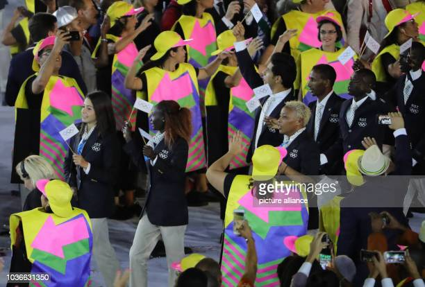 Athletes of Refugee Olympic Team with Syrian swimmer Yusra Mardini enter the stadium during the opening ceremony of the Rio 2016 Olympic Games at the...