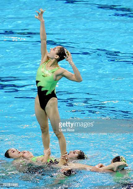 Athletes of Republic of Korea compete in the Team Technical Synchronised Swimming Routine at the 15th Asian Games Doha 2006 in the Hamad Aquatic...