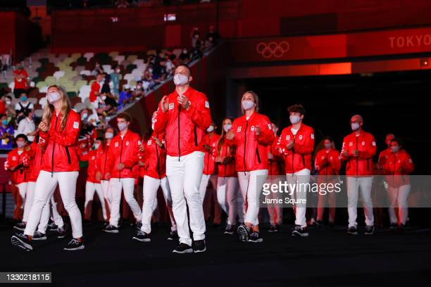 Athletes of Team Canada parade leaded by their flag bearers Miranda Ayim and Nathan Hirayama )not in frame) during the Opening Ceremony of the Tokyo...