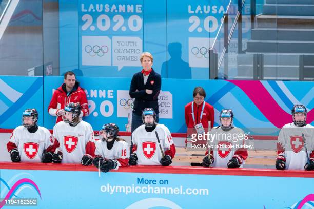 Athletes of Team Switzerland look on during Women's 6-Team Tournament Preliminary Round - Group B game between Czech Republic and Switzerland at the...