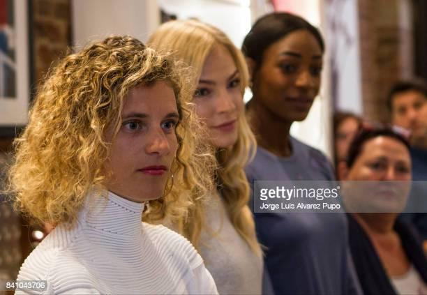 Athletes of the Memorial Van Damme Belgian sprinter Olivia Borlée Russian long jumper Darya Klishina and Bahamian sprinter Shaunae MillerUibo look on...