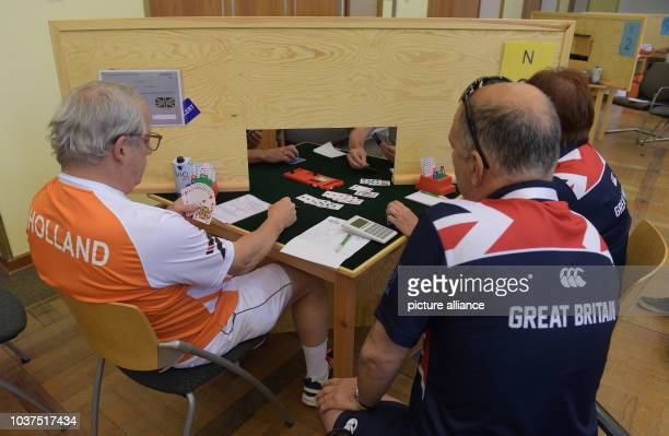 Athletes of the Netherlands and Britain compete in the card game Bridge during the European Maccabi Games at the Olympic Park in Berlin Germany 29...