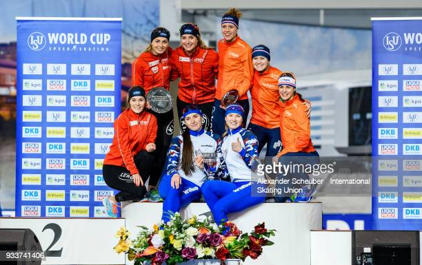 Athletes of the Netherlands Norway and Russia stand on the podium after the Overall Classification Ladies Team Sprint during the ISU World Cup Speed...
