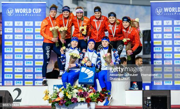 Athletes of the Netherlands Norway and Russia stand on the podium after the Ladies Team Sprint Final during the ISU World Cup Speed Skating Final Day...