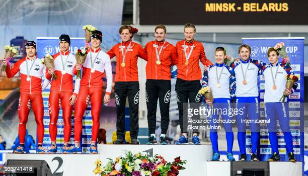 Athletes of the Poland Norway and Russia stand on the podium after the Men's Team Sprint Final during the ISU World Cup Speed Skating Final Day 2 at...