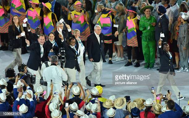 Athletes of the Refugee Olympic Team enter the stadium during the opening ceremony of the Rio 2016 Olympic Games at the Maracana stadium in Rio de...