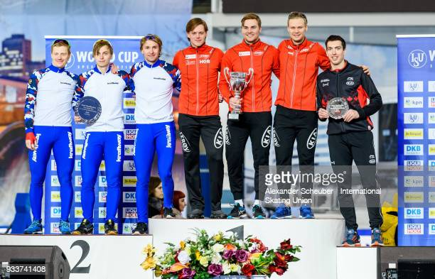 Athletes of the Russia Norway and Canda stand on the podium after the Overall Classification of the Men's Team Sprint during the ISU World Cup Speed...