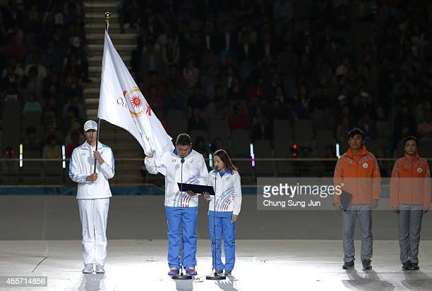 Athletes Oh JinHyuk of archery and Nam HyunHee of fencing take the Asian Games oath during the Opening Ceremony ahead of the 2014 Asian Games at...