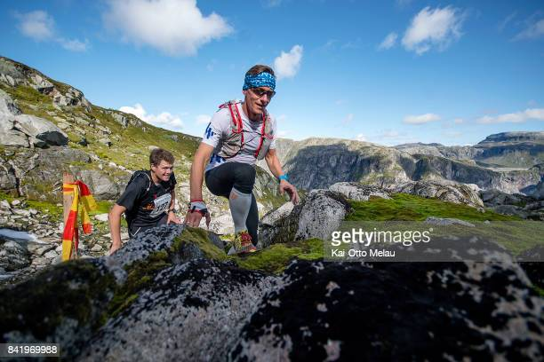 Athletes on the way up the first climb at Hardangervidda Marathon on September 2 2017 in Eidfjord Norway Hardangervidda Marathon goes through parts...