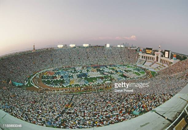 Athletes parade around the stadium infield during the opening ceremony for the XXIII Olympic Games on 28 July 1984 at the Los Angeles Memorial...