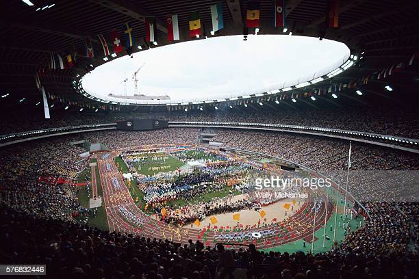 Athletes parade around the track at Olympic Stadium during the opening ceremony for the 1976 Summer Olympic Games