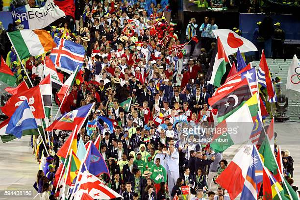 Athletes parade at the 'Heroes of the Games' segment during the Closing Ceremony on Day 16 of the Rio 2016 Olympic Games at Maracana Stadium on...