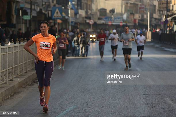 Athletes participate in the annual Amman International Marathon 2014 that is taking place in downtown Amman Jordan on October 24 2014 The Marathon...