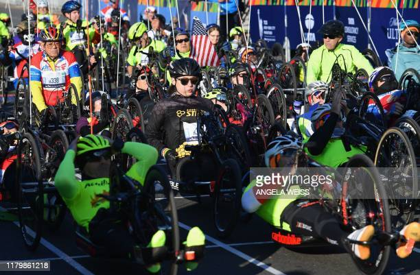 Athletes participate in the Handcycle Category and Select Ambulatory Athletes with Disabilities during the TCS New York City Marathon on November 3...