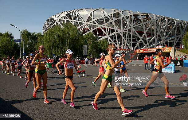 Athletes pass the Beijing National Stadium during the Women's 20km Race Walk final on day seven of the 15th IAAF World Athletics Championships...