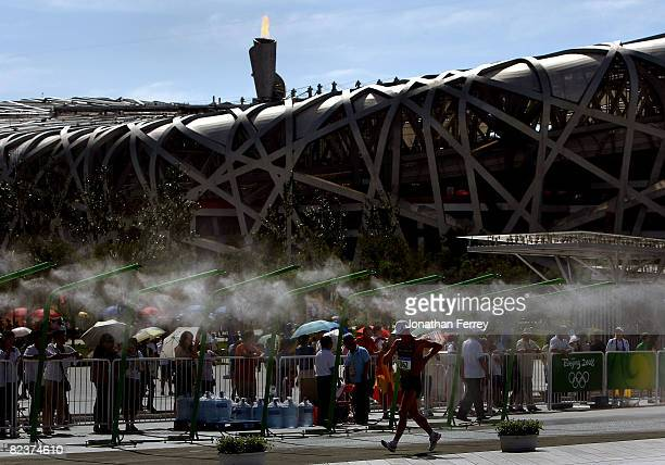 Athletes pass the Bird's Nest in the Men's 20km Walk Final at the National Stadium on Day 8 of the Beijing 2008 Olympic Games on August 16 2008 in...
