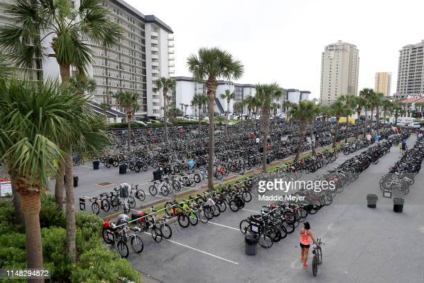 Athletes place their bikes at the transition point during the preview day for IRONMAN 703 Gulf Coast on May 10 2019 in Panama City Florida The 2019...