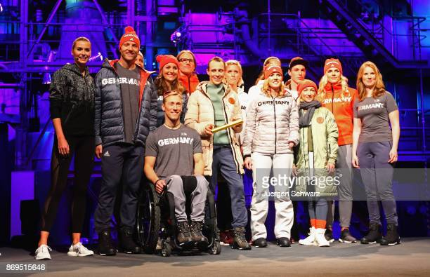 Athletes pose during the presentation of the outfit for German athletes competing in the upcoming Olympic Games in South Korea 2018 at Messe...