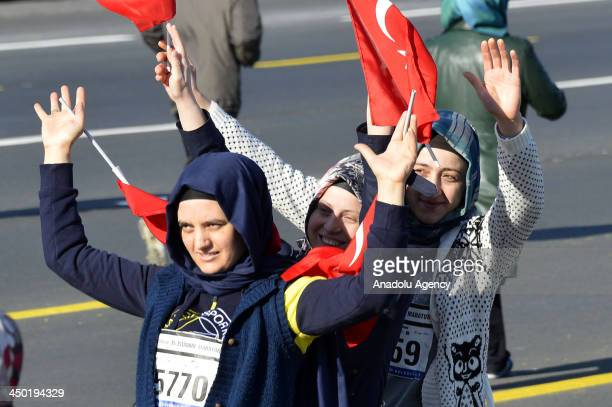 Athletes pose during the public walk through Bosphorus within the The 35th Istanbul Marathon on November 17 2013 in Istanbul Turkey The public walk...
