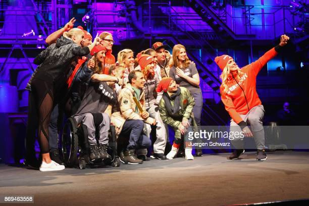 Athletes pose for a selfie during the presentation of the outfit for German athletes competing in the upcoming Olympic Games in South Korea 2018 at...