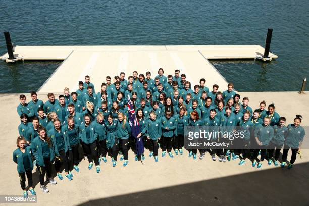 Athletes pose for a team photo during the Australian Youth Olympic Games Flag Bearer Announcement at The Boathouse St Ignatius' College Riverview on...
