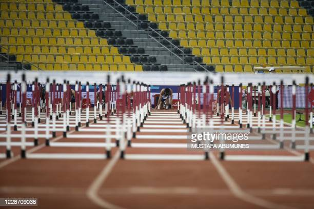 Athletes prepare for the start of the Men's 110m hurdles during the IAAF Diamond League competition on September 25, 2020 at the Suheim Bin Hamad...