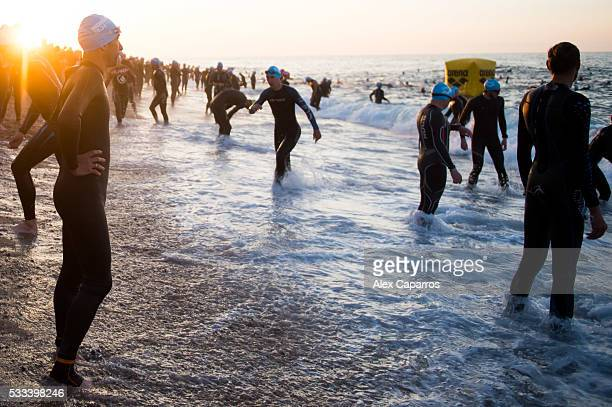 Athletes prepare for the swim leg of Ironman 703 Barcelona race on May 22 2016 in Barcelona Spain