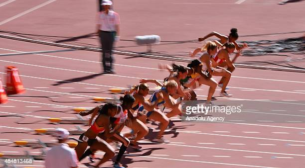 Athletes prepare to run in the women's 100 Metres Hurdles Heptathlon during the '15t IAAF World Athletics Championships Beijing 2015' at Beijing...