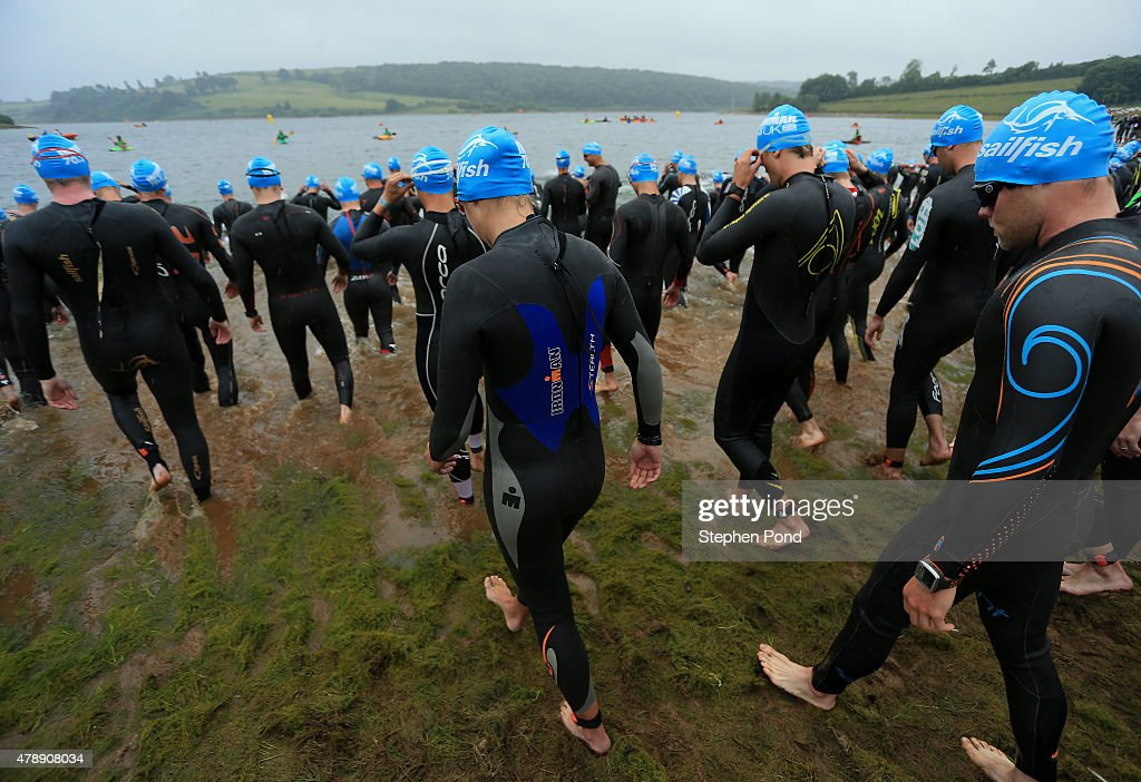 Athletes prepare to start the swim during the Ironman 70.3 Exmoor event on June 28, 2015 in Exmoor National Park, England.