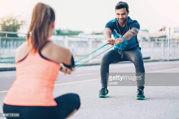 athletes pulling resistance band - train band stock photos and pictures