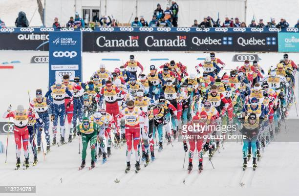 Athletes race during the men's FIS World Cup Mass Start 15km March 23 on the second day of the FIS CrossCountry World Cup finals in Quebec city
