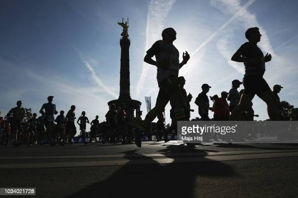 Athletes race past the Berlin Victory Column during the Berlin Marathon 2018 on September 16 2018 in Berlin Germany