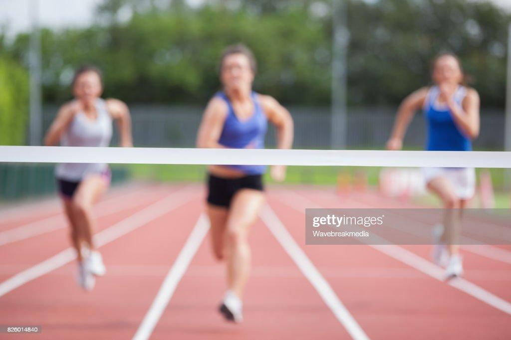 Athletes racing towards finish line : Stock Photo