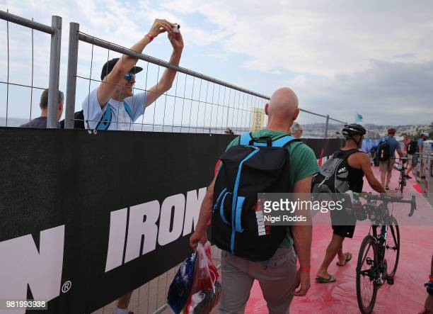 Athletes queue to rack their bikes ahead of Ironman Nice on June 23 2018 in Nice France