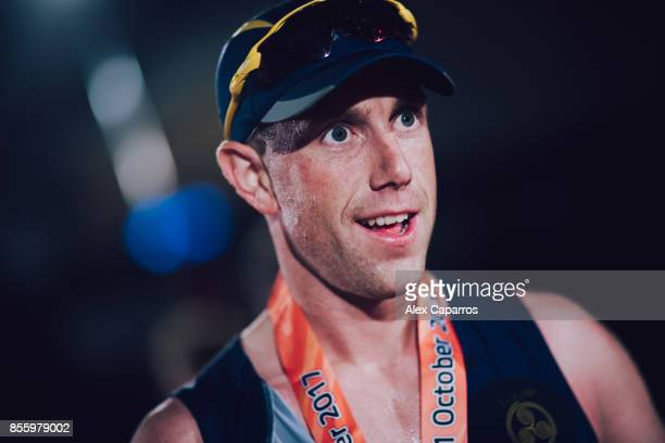 Athletes react after crossing the finish line of the IRONMAN Barcelona on September 30 2017 in Calella Barcelona province Spain